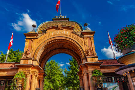 COPENHAGEN, DENMARK - JUNE 15, 2018: Entrance to Tivoli Gardens amusement park in Copenhagen, Denmark. Park was opened in 1843 and  is second oldest operating amusement park in the world