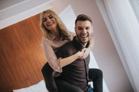 Lovely young couple having fun in the room