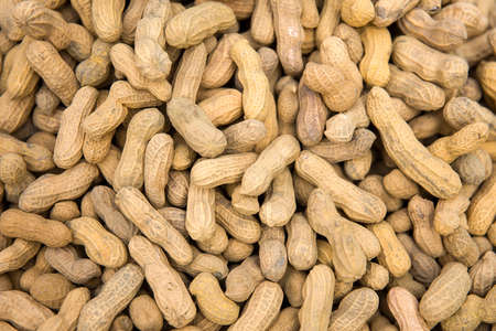 Closeup detail view at peanuts shells on the market