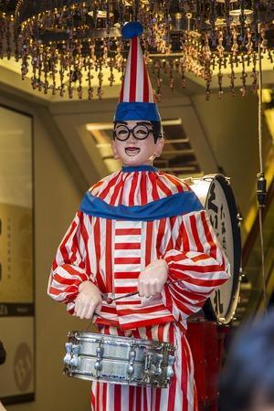 OSAKA, JAPAN - OCTOBER 9, 2016: Kuidaore Taro mechanicl drum playing clown at Dotonbori in Osaka, Japan. It is an Osaka symbol installed in 1950.
