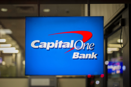 NEW YORK, USA - AUGUST 27, 2017: Sign of Capital One Bank in New York, USA. It is a bank holding company headquartered in McLean, Virginia. Imagens - 104751036
