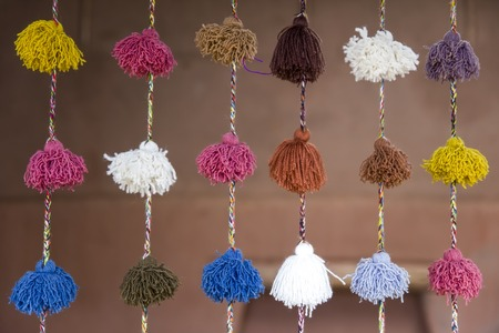 View at colorful wool samples hanging on the market 写真素材