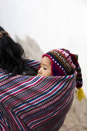CUSCO, PERU - JANUARY 6, 2018: Unidentified child from Cusco, Peru. Cusco is a city in the Peruvian Andes and once was capital of the Inca Empire.