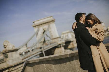Young happy attractive couple in love hugging with background of the magnificent view of Budapest, Hungary Stock fotó