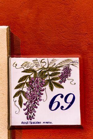 PORTOFINO, ITALY - APRIL 29, 2017: Decorative street number plate from Portofino, Italy. Portofino is one of the most popular resort towns on the Italian Riviera.