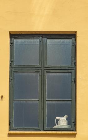 Window on the colorful facade from Nyhavn harbour, Copenhagen, Denmark