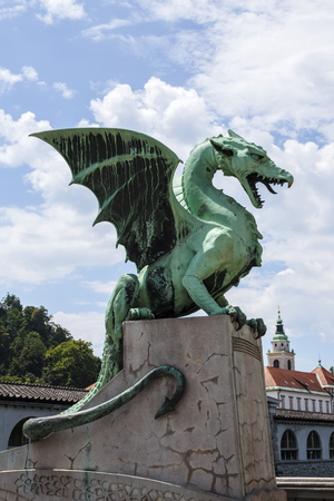 View at dragon sculpture on the Dragon bridge in Ljubljana, Slovenia, made by Giorgio Zaninovich at 1901. 報道画像