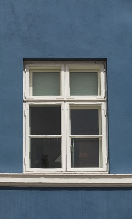 Window on the colorful facade from Nyhavn harbour, Copenhagen, Denmark