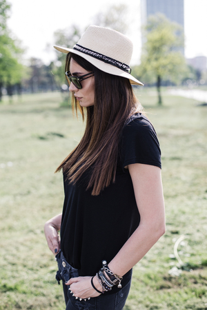 Stylish young woman in the park on a summer day Banco de Imagens