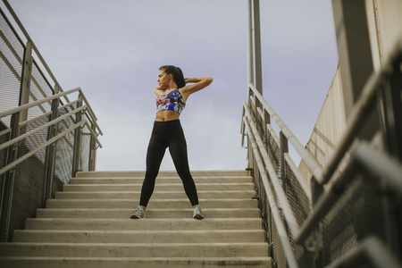 Young woman exercise in urban enviroment Stock Photo