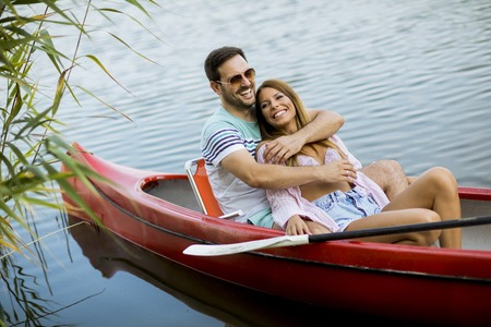 Close up portrait of hugged romantic couple boating on the lake