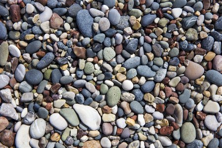 Closeup of the beach pebbles on a sunny day