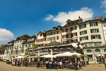 RAPPERSWIL, SWITZERLAND - MAY 18, 2018: Unidentified people sitting in restaurants in Rapperswil, Switzerland. This town located on the upper end of Lake Zurich is popular tourist destination.