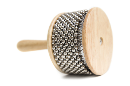 Cabasa percussion instrument isolated on the white background