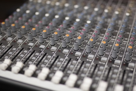 Close up view at mixing console in studio
