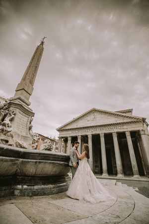Beautiful young wedding couple by the Pantheon in Rome, Italy Stock fotó