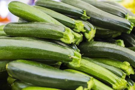 Close up view at zucchini on maket Stockfoto
