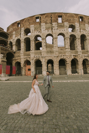 Wedding couple near  Colosseum in Rome, Italy, Europe