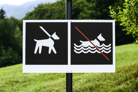 View at no dog bathing sign on signpost