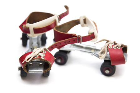 Pair of retro antique skates isolated on the white background