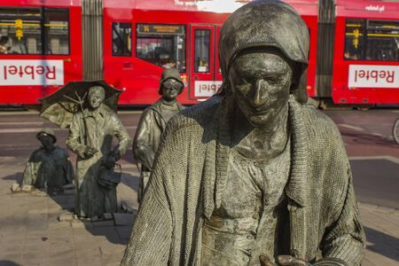 WROCLAW, POLAND - JUNE 11, 2018: The Anonymous Pedestrians sculptures from Wroclaw, Poland. These 14 figures were made by Polish artist Jerry Kalina in 2005. Publikacyjne