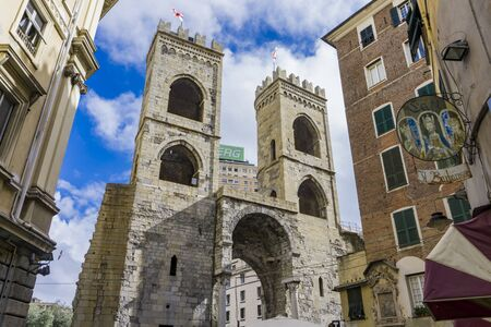 GENOA, ITALY - APRIL 29, 2017: Detail of the Porta Soprana in Genoa, Italy. This monumental gate was built at 1155 as part of a defensive wall system