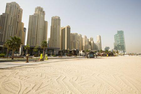 DUBAI, UAE - MAY 6, 2015: View at Marina beach in Dubai, UAE. Marina beach is popular tourist destination in Dubai.