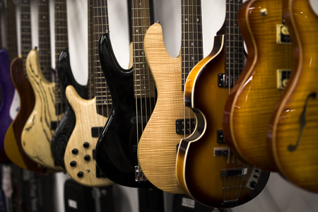 Clolection of electric guitars hanging in shop