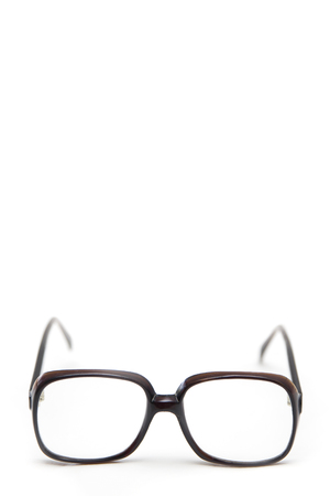 Vintage antique eyeglasses isolated on the white background with empty copyspace