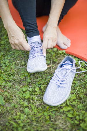 Close up view at woman wearing sport shoes at outdoor Stok Fotoğraf