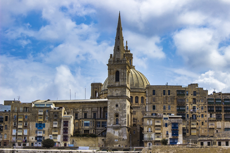 View at dome of Our Lady of Mount Carmel church and St Pauls Cathedral in Valletta, Malta