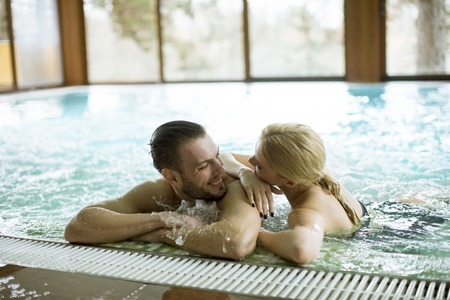 Loving couple relaxing in hot tub in spa 版權商用圖片