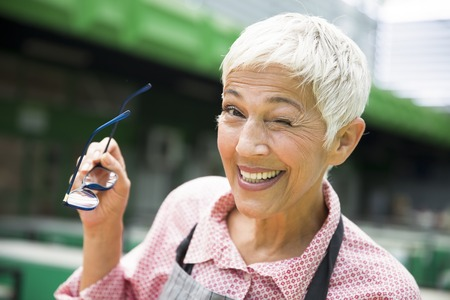 Portrait of an senior woman with wrinkles who hints