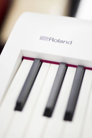 BELGRADE, SERBIA - JULY 23, 2018: Detail of Roland electronic keyboard. Roland is a Japanese manufacturer of electronic musical instruments and electronic equipment