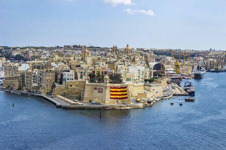 VALLETTA, MALTA - SEPTEMBER 9, 2017: View at Valletta port at Malta. Port of Valletta is the largest natural harbor in Europe
