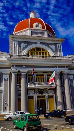 CIENFUEGOS, CUBA - MAY 25, 2014: Unidentified people by Palacio Del Gobierno at Cienfuegos, Cuba. Urban Historic Centre of Cienfuegos was sesignated as UNESCO World Heritage Site since 2005.