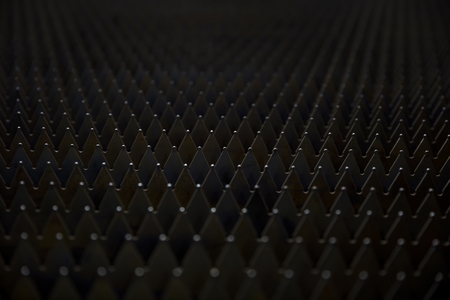 Detail of the sheet metal spikes backdrop Stock Photo