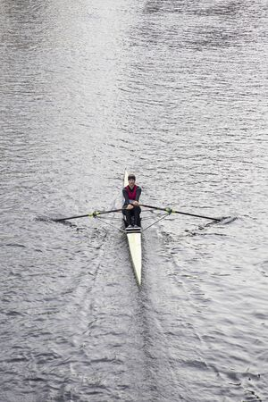 HANOVER, GERMANY - OCTOBER 27, 2018: Unidentified woman rowing in Hanover, Germany. Thanks to the Maschsee lake, the rivers Ihme and Leine Hanover hosts many rowing clubs.