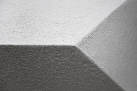 Closeup of the geometric stone wall detail backdrop