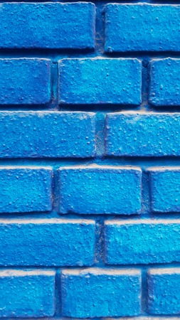 Closeup detail of the blue brick wall