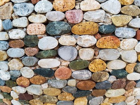 Detail of the colorful round stones wall backdrop