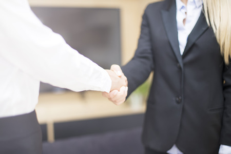 Two businesswomen shaking hands as they close a deal or partnership Stock Photo - 112870729
