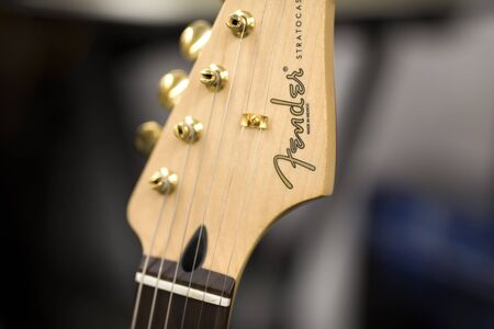 BELGRADE, SERBIA - JULY 23, 2018: Detail of the Fender guitar in Belgrade, Serbia. Fender Musical Instruments Corporation is an American manufacturer of stringed instruments and amplifiers founded at