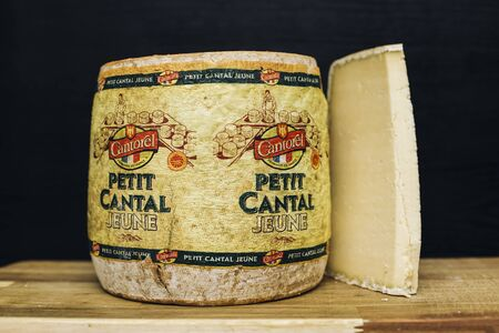 BELGRADE, SERBIA - NOVEMBER 22, 2018: Detail of Petit cantal jeune cheese in Belgrade, Serbia. Cantal cheese jeune is a type of firm cheese produced in the Auvergne region of central France, aged 1-2 months.
