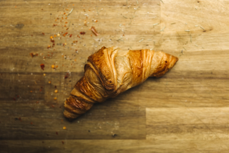 Fresh french croissant on the wooden table