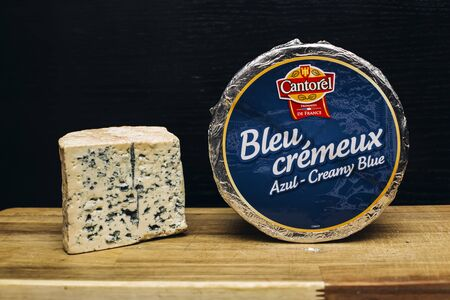 BELGRADE, SERBIA - NOVEMBER 22, 2018: Detail of Bleu cremeux cheese in Belgrade, Serbia. It is a mild and creamy cow's milk cheese, made in the Auvergne region of South France