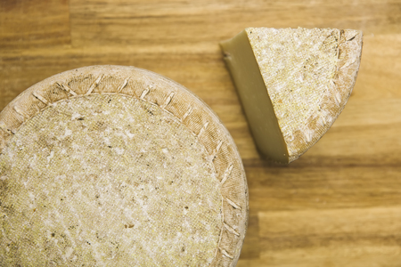 Traditional Auvergne cheese from France on the wooden table