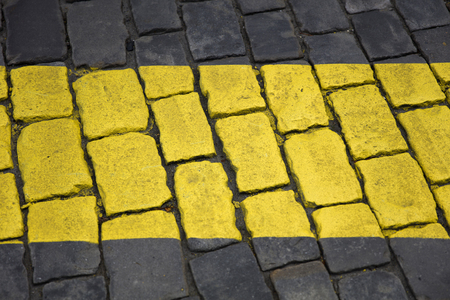 Closeup detail of the yellow line sign on the pavement