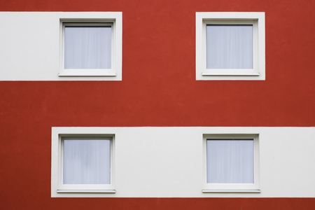 Residential home with modern red and white facade painting