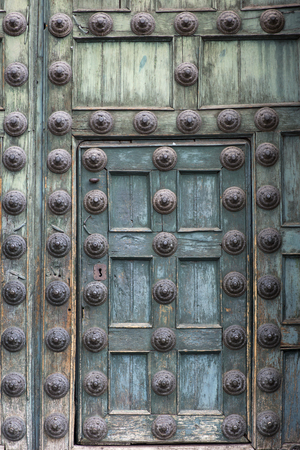 Vintage old wooden door with round decorations